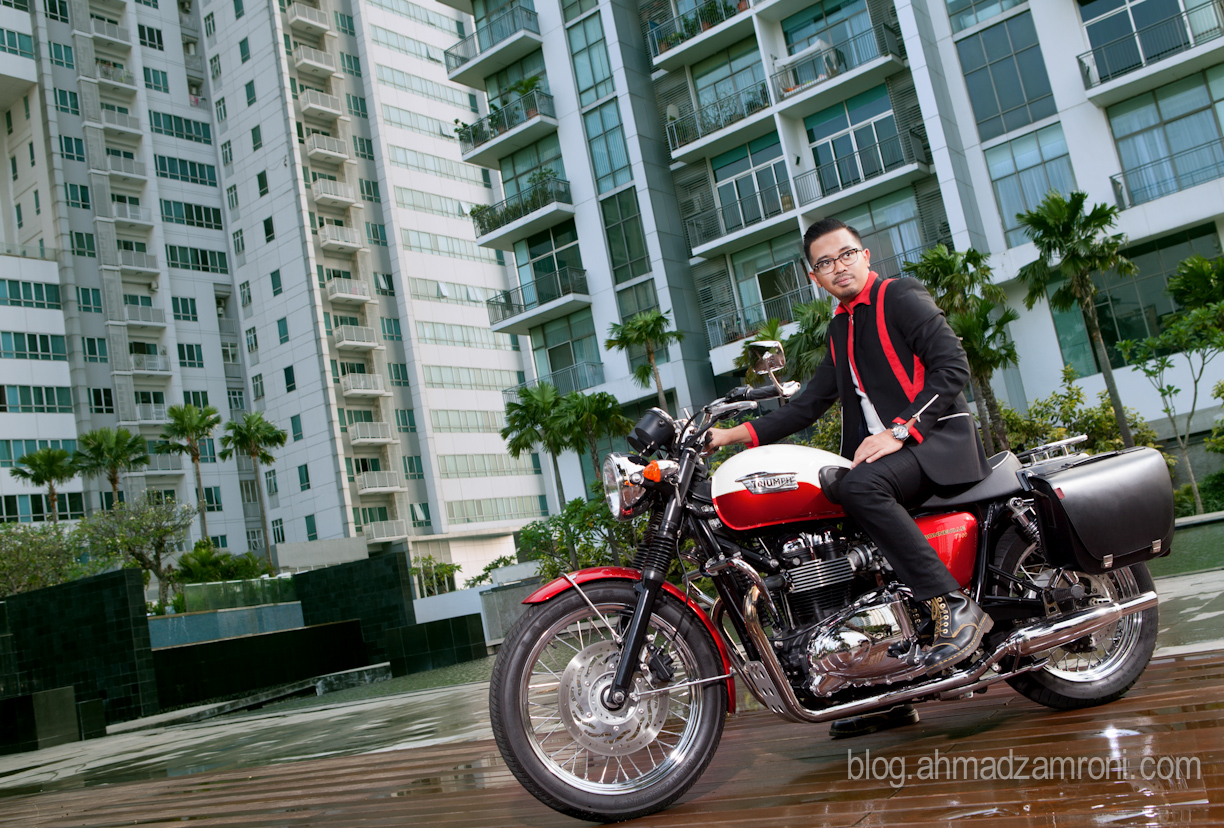Adrian Bramantyo Musyanif, 26, CEO of Samali hotels & resorts, with his 2013 Triumph Bonneville T100.